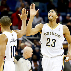Nov 22, 2013; New Orleans, LA, USA; New Orleans Pelicans power forward Anthony Davis (23) celebrates with shooting guard Eric Gordon (10) during the fourth quarter of a game at New Orleans Arena. The Pelicans defeated the Cavaliers 104-100. Mandatory Credit: Derick E. Hingle-USA TODAY Sports