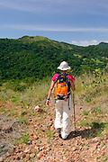 Woman ascending to Cerro La Cruz summit. Taboga island, Panama Gulf, Panama province, Panama, Central America.