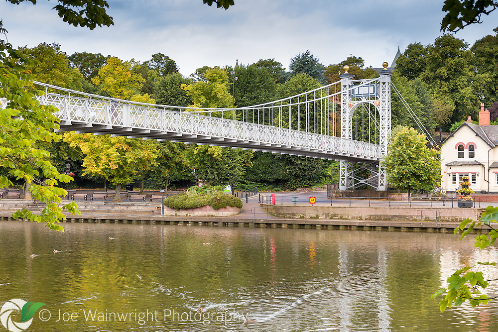 The suspension bridge across the Dee in Chester, was opened in 1923 and connects the suburb of Queen's Park with the city. Photographed in August.
