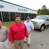 Thomas Wells | BUY at PHOTOS.DJOURNAL.COM<br /> Allen Hughes, from left, Corey Clark, and Andy Phillips of Clark Ford