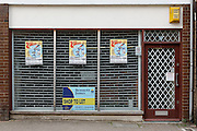 Unmarked vacated shop window with Zippos Circus posters, Dursley.Recession 2010: Parsonage Street, Dursley, Gloucestershire shops closed due to economic downturn.