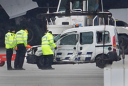 © Licensed to London News Pictures. 14/02/2018. London, UK. Police remove a damaged vehicle from the tarmac at Heathrow Airport after this morning's fatal crash near Terminal 5. Photo credit: Peter Macdiarmid/LNP