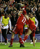 Photo: Paul Thomas/Sportsbeat Images.<br /> Liverpool v Besiktas. UEFA Champions League. 06/11/2007.<br /> <br /> While Yossi Benayoun (11) of Liverpool celebrates his goal, team-mate Alvaro Arbeloa jumps on his shoudlers, but falls off.