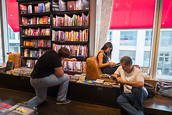 Interior of large bookstore and media shop Dussmann on Friedrichstrasse in Mitte, Berlin, Germany.