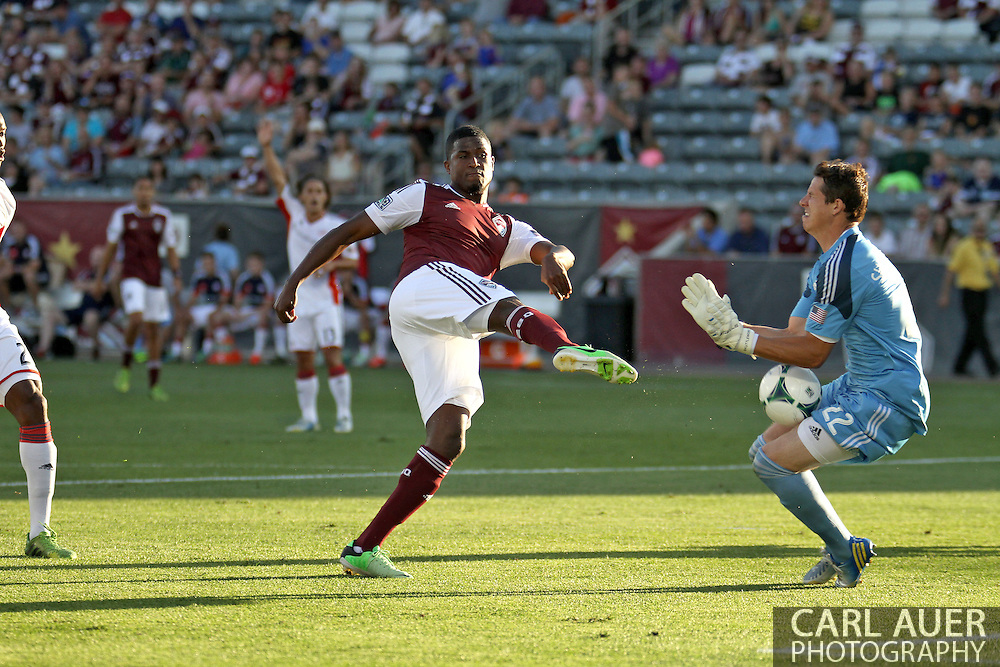 July 17th, 2013 - New England Revolution goalkeeper Bobby Shuttleworth (22) blocks a point blank shot attempt by Colorado Rapids forward Edson Buddle (9) in the fist half of action in the Major League Soccer match between the New England Revolution and the Colorado Rapids at Dick's Sporting Goods Park in Commerce City, CO