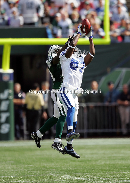 EAST RUTHERFORD, NJ - OCTOBER 1:  Wide receiver Reggie Wayne #87 of the Indianapolis Colts leaps to catch a fingertip pass while defended by cornerback Justin Miller #22 of the New York Jets at the Meadowlands on October 1, 2006 in East Rutherford, New Jersey. The Colts defeated the Jets 31-28. ©Paul Anthony Spinelli *** Local Caption *** Reggie Wayne;Justin Miller