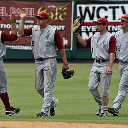 June 03, 2011; Tallahassee, FL, USA;  Alabama Crimson Tide right fielder Andrew Miller celebrates with teammates after getting the final out in the bottom of the ninth inning against the UCF Knights during the 2011 Tallahassee Regional at Dick Howser Stadium. Alabama defeated UCF 5-3. Mandatory Credit: Derick E. Hingle