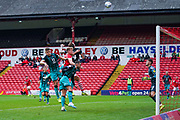 Barnsley midfielder Cameron McGeehan (8) rises above a group of Swansea City players to head over during the EFL Sky Bet Championship match between Barnsley and Swansea City at Oakwell, Barnsley, England on 19 October 2019.