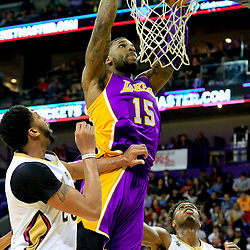 Nov 12, 2016; New Orleans, LA, USA;  Los Angeles Lakers forward Thomas Robinson (15) dunks over New Orleans Pelicans forward Anthony Davis (23) during the second quarter of a game at the Smoothie King Center. Mandatory Credit: Derick E. Hingle-USA TODAY Sports
