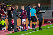 Steven Naismith (#14) of Heart of Midlothian FC  goes off injured after clashing heads with Marvin Bartley (#6) of Livingston FC during the Ladbrokes Scottish Premiership match between Heart of Midlothian FC and Livingston FC at Tynecastle Park, Edinburgh, Scotland on 4 December 2019.