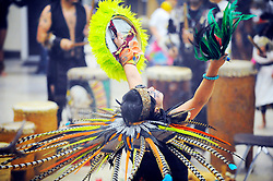 "In their sixth annual performance called ""Day of Indigenous Resistance,"" Xochinecuhtli Alvarez (Nectar of a Flower) of the Salinas dance group Yaocuauhtli looks to the sky. Held as a deliberate counterpoint to Columbus Day on October 12th, which is also sometimes called ""Day of the Races,"" or ""Hispanic Day,"" the event was meant to highlight long-standing New World traditions, saying ""We are Aztecas, Zapotecas, Mexicas, Toltecas, Huicholes, Trikis, Mayas, Incas, Tarahumara, etc,"" and encouraging everyone to express pride in their pre-Colombian identities."
