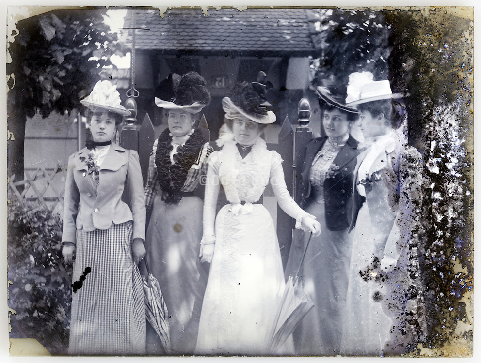 fashionable dressed women on fading glass plate image Paris 1900s