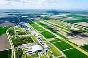 Nederland, Flevoland, Gemeente Lelystad, 07-05-2015; Vliegveld Lelystad, Lelystad Airport, call sign EHLE. Vliegveld voor General Aviation (GA), kleine luchtvaart, onderdeel Schiphol Group. Er zijn uitbreidingsplannen om de groei van het luchtverkeer mogelijk te maken. Ook Nationaal Luchtvaart-Themapark Aviodrome, met KLM vliegtuig. Naast de start- en landingsbaan de testbaan van de Rijksdienst voor het Wegverkeer (RDW).<br /> Lelystad Airport in the polder and province Flevoland.<br /> luchtfoto (toeslag);<br /> aerial photo (additional fee required); <br /> copyright foto/photo Siebe Swart.