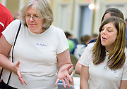 High school teacher Kathy Hudson and student Alex Jone cheer during the car competition at the Russ College of Engineering and Technology research fair/engineering day in the Baker Center ballroom on Thursday, 5/3/07.