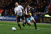 Joey Barton of Burnley gets around Calum Woods of Preston during the Sky Bet Championship match between Preston North End and Burnley at Deepdale, Preston, England on 22 April 2016. Photo by Simon Brady.