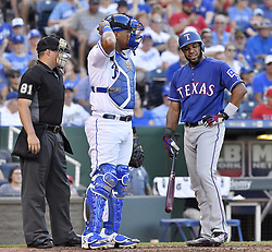 July 15, 2017 - Kansas City, MO, USA - Texas Rangers' Elvis Andrus complained to home plate umpire Quinn Wolcott after being called out looking at strike three in front of Kansas City Royals catcher Salvador Perez in the fourth inning July 15, 2017 at Kauffman Stadium in Kansas City, Mo. The Rangers won, 1-0. (Credit Image: © John Sleezer/TNS via ZUMA Wire)