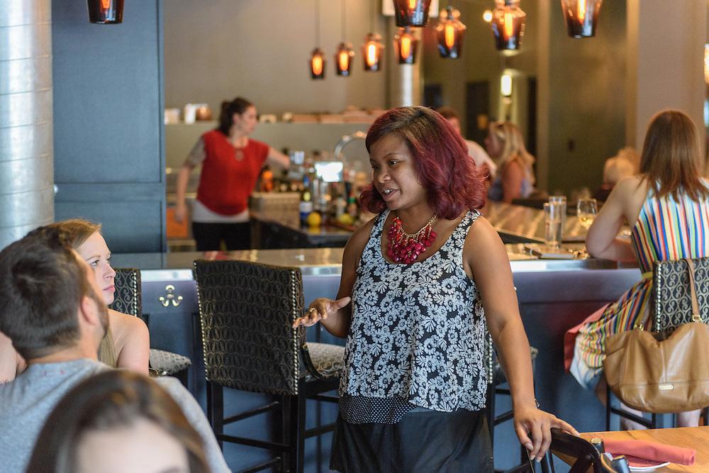 Felicia Corbett serves during dinner at Louvino, Thursday, Aug. 18, 2016. (Photo by Brian Bohannon)