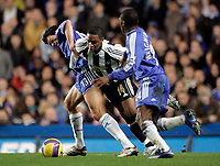 Photo: Marc Atkins.<br /> Chelsea v Newcastle United. The Barclays Premiership. 13/12/2006. Michael Ballack (L) and Shaun Wright Phillips (R) of Chelsea tangle with Charles N' Zogbia  (C) of Newcastle.
