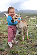 Stunning images reindeer herders of Mongolia<br /> <br /> Tsaatan people are reindeer herders and live in northern Khövsgöl Aimag of Mongolia. Originally from across the border in what is now Tuva Republic of Russia,the Tsaatan are one of the last groups of nomadic reindeer herders in the world. They survived for thousands of years inhabiting the remotest Ulaan taïga, moving between 5 and 10 times a year. <br /> The reindeer and the Tsaatan people are dependent on one another. Some Tsaatan say that if the reindeer disappear, so too will their culture. The Tsaatan depend on the reindeer for almost, if not all, of their basic needs:  their reindeers provide them with milk, cheese, meat, and transportation. They sew their clothes with reindeer hair, reindeer dung fuels their stoves and antlers are used to make tools. They do not use their animals for meat. This makes their group unique among reindeer-herding communities. As the reindeer populations shrink, only about 40 families continue the tradition today. Their existence is threatened by the dwindling number of their domesticated reindeer. Many have swapped their nomadic life for urban areas. <br /> <br /> Tuvshinbayar & Ulziisaihan, children of Narahuu & Bolorma<br /> ©Pascal MANNAERTS/Exclusivepix Media