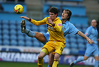Photo: Pete Lorence.<br />Coventry City v Burnley. Coca Cola Championship. 09/12/2006.<br />Elliott Ward slams the ball away from Kyle Lafferty.
