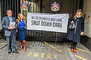 Environmental protestors lobby Drax shareholders as they arrive for its Annual General Meeting. This group made it in to the meeting but were ejected after asking their questions. They then picket the exit in an attempt to encourage investors to sell their shares because of risk added to the price as a result of  reliance on subsidies. Grocers hall, Bank, London, UK 23 April 2014.