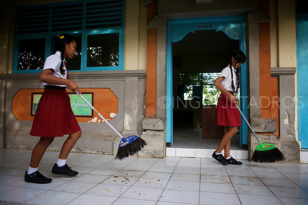 Girls at school, cleaning up after a midterm break.<br />