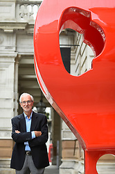 "© Licensed to London News Pictures. 12/09/2018. LONDON, UK. Internationally renowned architect and Honorary Royal Academician Renzo Piano at a preview of ""Renzo Piano: The Art of Making Buildings"", an exhibition comprising 16 of his most significant projects.  He is seen next to a 'gerberette', a full sized copy of a die-cast rocker beam used in the Centre George Pompidou in Paris,   The exhibition runs 15 September to 20 January 2019 at the Royal Academy of Arts in Piccadilly.  Photo credit: Stephen Chung/LNP"