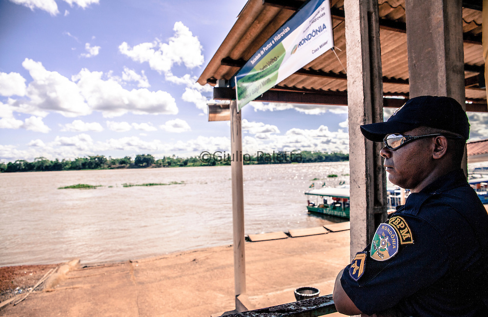 Guajarà-Mirim, Brazil. Policeman Sr.Motta looking at the Bolivian side of the border, in front of him.