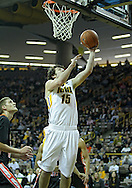 December 04 2010: Iowa Hawkeyes forward Zach McCabe (15) puts up a shot during the first half of their NCAA basketball game at Carver-Hawkeye Arena in Iowa City, Iowa on December 4, 2010. Iowa won 70-53.