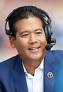 Rob Fukuzaki, the weekday ABC7 sports anchor for Eyewitness News channel 7 television, smiles as he broadcasts from field level before the 2016 NFL preseason football game against the Dallas Cowboys on Saturday, Aug. 13, 2016 in Los Angeles. The Rams won the game 28-24. (©Paul Anthony Spinelli)