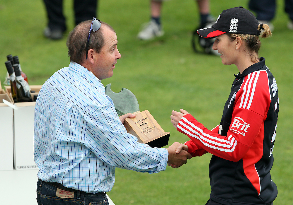Southland Cricket's Ian Mockford presents England's Charlotte Edwards the series trophy after defeating New Zealand in the twenty/20 International Women's Cricket, Invercargill Cricket Oval, New Zealand, Sunday, February 26, 2012. Credit:SNPA / Dianne Manson.