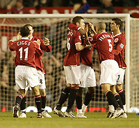Photo: Aidan Ellis.<br /> Manchester United v Chelsea. The Barclays Premiership. 26/11/2006.<br /> United's louis Saha is congratulated on his goal by team mates Rio Ferdinand, Michael Carrick and Cristiano Ronaldo