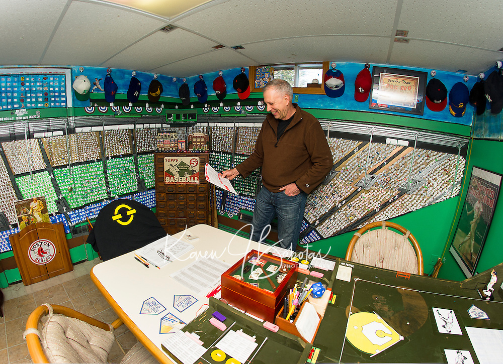 """Bill Colby in his """"Fenway Park"""" room filled with the history of American Baseball.  (Karen Bobotas/for the Laconia Daily Sun)"""