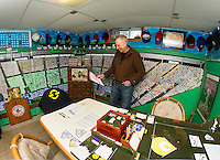 "Bill Colby in his ""Fenway Park"" room filled with the history of American Baseball.  (Karen Bobotas/for the Laconia Daily Sun)"