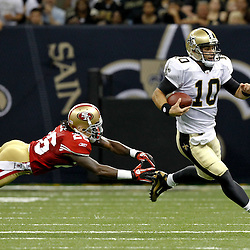 August 12, 2011; New Orleans, LA, USA; New Orleans Saints quarterback Chase Daniel (10) escapes the grasp of San Francisco 49ers corner back Tramaine Brock (26) during the first half of a preseason game at the Louisiana Superdome. Mandatory Credit: Derick E. Hingle