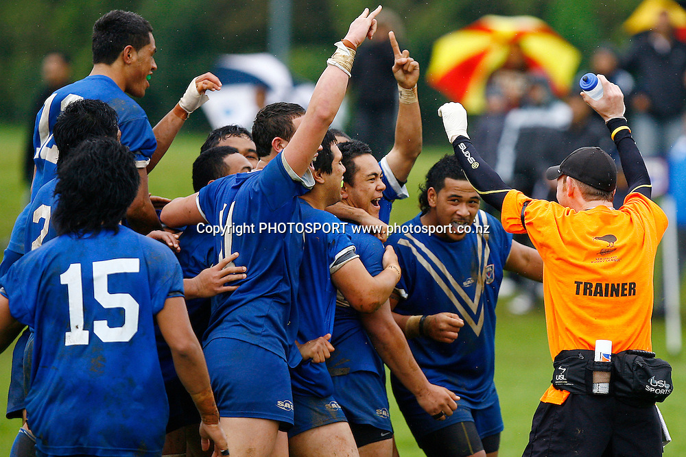 Auckland's Ernest Alo is crowded by teammates after landing a field goal in extra time to win the game for Auckland. National Junior Competitions, Under-16, Foundation Cup Final, Auckland v Taranaki at Cornwall Park, Auckland, New Zealand. Sunday 4th October 2009. Photo: Anthony Au-Yeung/PHOTOSPORT