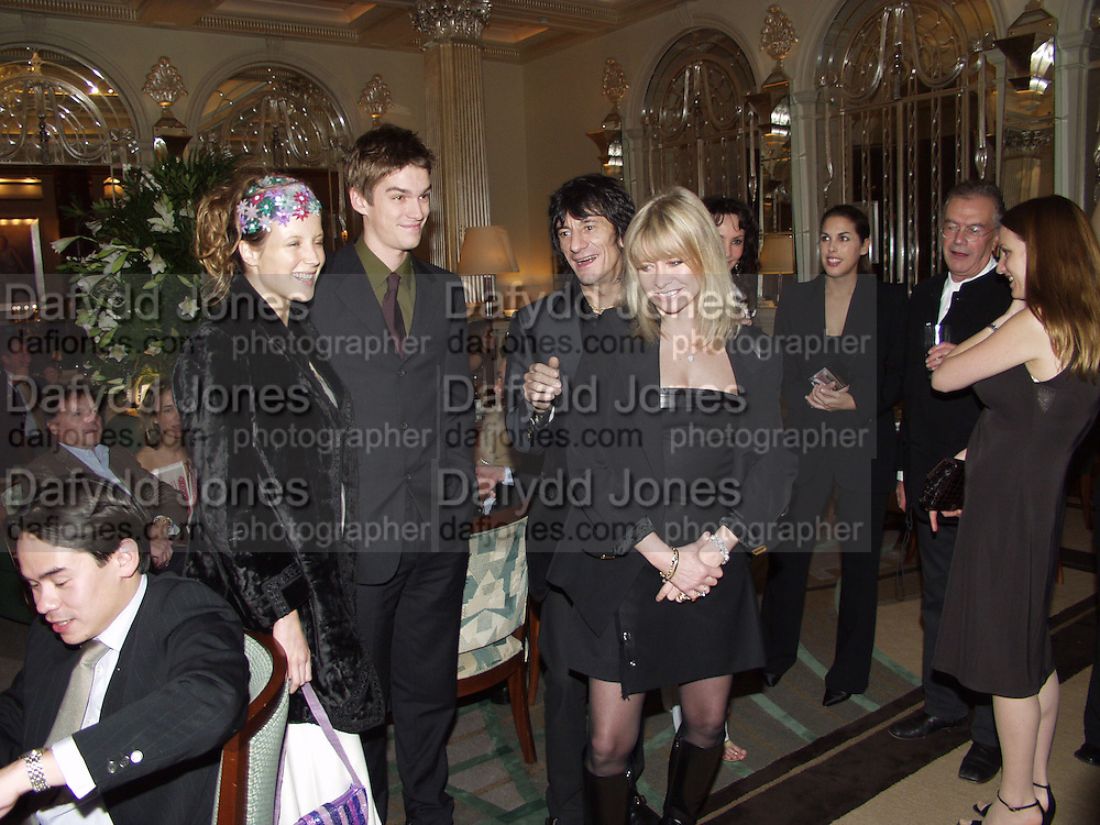 Lee Boone, Jesse Wood, Ronnie Wood and Jo Wood. David Bailey dinner hosted by Lucy Yeomans at Gordon Ramsay at Claridge's. 12 November 2001. © Copyright Photograph by Dafydd Jones 66 Stockwell Park Rd. London SW9 0DA Tel 020 7733 0108 www.dafjones.com