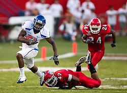 Sep. 18, 2009; Fresno, CA, USA; Boise State Broncos running back D.J. Harper (6) breaks a tackle by Fresno State Bulldogs defensive tackle Terrance Kindle (47) on a 60 yard touchdown run during the second quarter at Bulldog Stadium.
