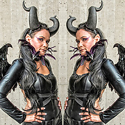 Cosplayer in her Maleficent costume at the New York Comic Con.<br /> <br /> Photographic series of digital computer art from an image of Maleficent. <br /> <br /> Two or more layers were used to enhance, alter, manipulate the image, creating an abstract surrealistic mirrored symmetry.