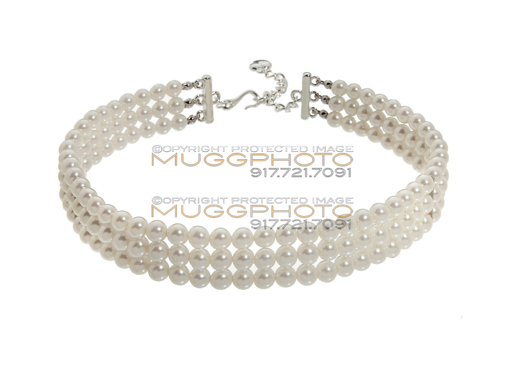 Three strand pearl choker necklace on white background
