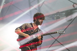 © Licensed to London News Pictures . 21/07/2013 . Suffolk , UK . Yannis Philippakis . Foals play at the Obelisk Arena as the closing act on the festival's main stage . The Latitude music and culture festival in Henham Park , Southwold . Photo credit : Joel Goodman/LNP