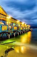 Trapiche do Restaurante Ostradamus, na Praia do Ribeirão da Ilha, ao anoitecer. Florianópolis, Santa Catarina, Brasil. / Pier of Ostradamus Restaurant, at Ribeirao da Ilha Beach, at dusk. Florianopolis, Santa Catarina, Brazil.
