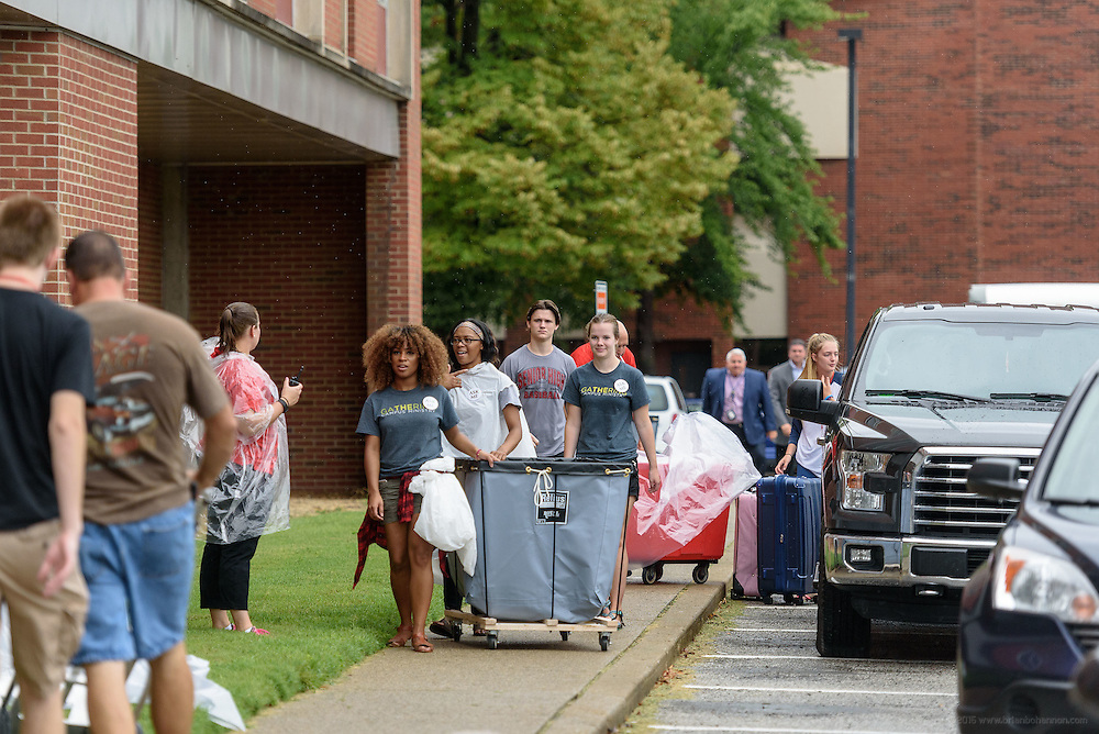 Volunteers from campus organizations use carts behind Threlkeld Hall to help incoming freshmen move their belongings as first-time students move in to Belknap Campus dormitories Wednesday during University of Louisville's Welcome Week. Aug. 17, 2016