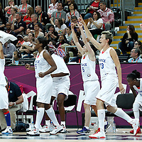 30 July 2012: Team France celebrates during the 74-70 Team France overtime victory over Team Australia, during the women's basketball preliminary, at the Basketball Arena, in London, Great Britain.