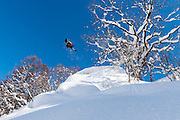 Lucas Debari, frontside 360 over a pillow stack. Hakuba backcountry, Japan.