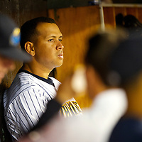 New York Yankees Third Baseman Alex Rodriguez sits in the dugout during a minor league game for the AA Trenton Thunder in Trenton, NJ on August 3, 2013.  He is facing a suspension by Major League Baseball for his alleged use of steroids with the Biogenesis clinic in Florida.