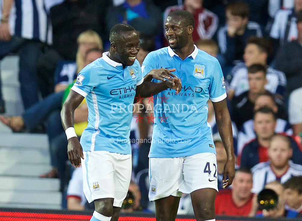 WEST BROMWICH, ENGLAND - Monday, August 10, 2015: Manchester City's Yaya Toure celebrates scoring the second goal against West Bromwich Albion with team-mate Bacary Sagna during the Premier League match at the Hawthorns. (Pic by David Rawcliffe/Propaganda)