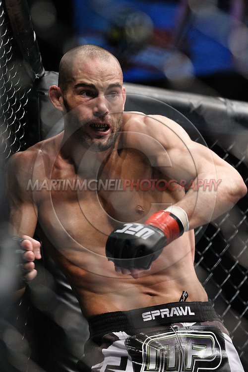 "MANCHESTER, ENGLAND, NOVEMBER 14, 2009: Mike Swick falls against the cage wall during ""UFC 105: Couture vs. Vera"" inside the MEN Arena in Manchester, United Kingdom."