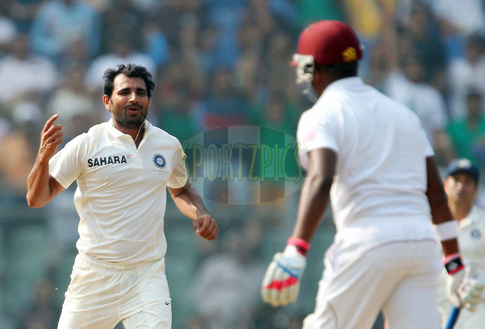 Mohammed Shami of India appeals for the wicket of Darren Bravo of West Indies  during day one of the second Star Sports test match between India and The West Indies held at The Wankhede Stadium in Mumbai, India on the 14th November 2013<br /> <br /> This test match is the 200th test match for Sachin Tendulkar and his last for India.  After a career spanning more than 24yrs Sachin is retiring from cricket and this test match is his last appearance on the field of play.<br /> <br /> <br /> Photo by: Ron Gaunt - BCCI - SPORTZPICS<br /> <br /> Use of this image is subject to the terms and conditions as outlined by the BCCI. These terms can be found by following this link:<br /> <br /> http://sportzpics.photoshelter.com/gallery/BCCI-Image-Terms/G0000ahUVIIEBQ84/C0000whs75.ajndY
