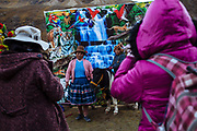 Local photographers mount a big background with images of tigers, macaws and waterfalls to take photos to the pilgrims in the way to the Lord of Qoyllur Rit'i sanctuary Cusco, Peru.